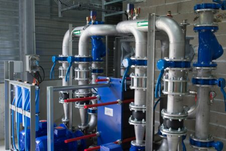 industrial pipes and blue pumps need Texas pump repair
